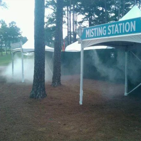 Misting tents and misting station at an outdoor forest location