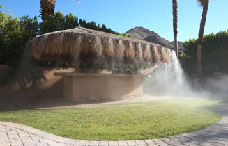 Residential misting system installed in a patio of a backyard