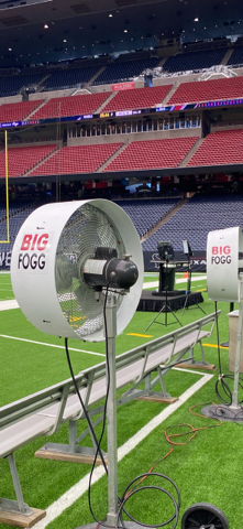 Portable misting fans installed all over the unoccupied football field