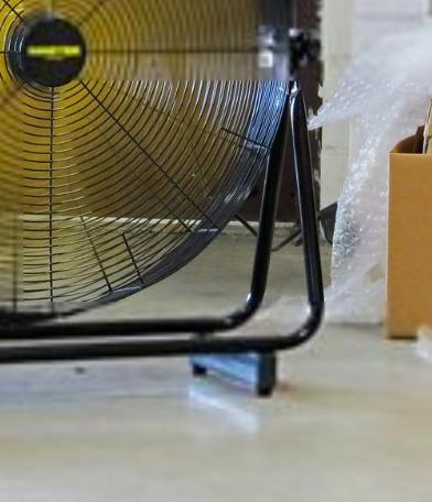 "30"" High Velocity High Velocity Floor Fan on the floor closeup from bottom"