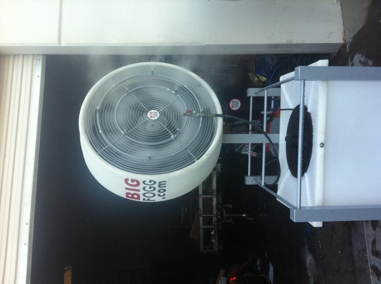 Big Fogg High-Pressure Misting Fan with 40' Gallon Tank outside a garage